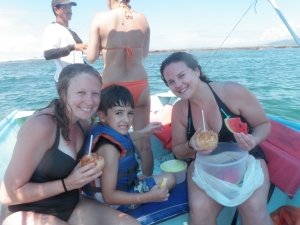 Us and Andres enjoying our fresh coconut on the boat